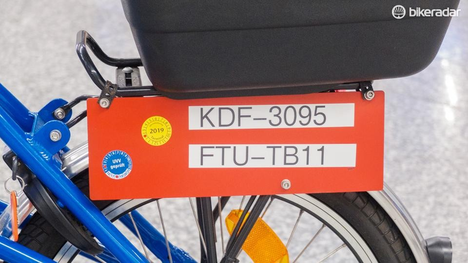 Each bike is marked with a unique number plate