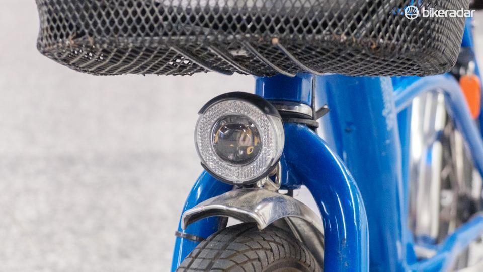 A dynamo hub powers a small head light and tail light