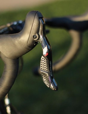 The FSA K-Force WE electronic group shifts wirelessly and the derailleurs are wired to a single battery