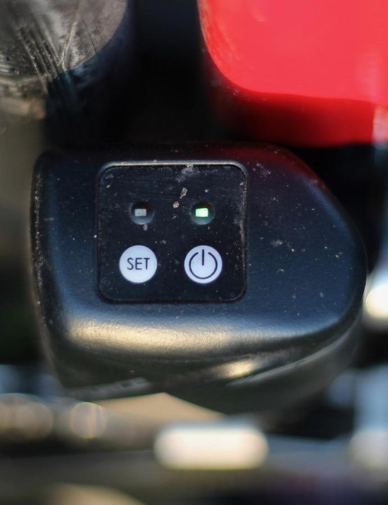 A green light indicates an active shift command. The front-most light (at right, here) indicating the front derailleur, the other indicating the rear derailleur