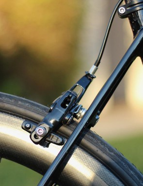New dual-pivot brake calipers feature stout arms for stiffness