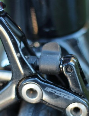 The matte gray quick-release lever (just above the FSA logo) in the up/open position