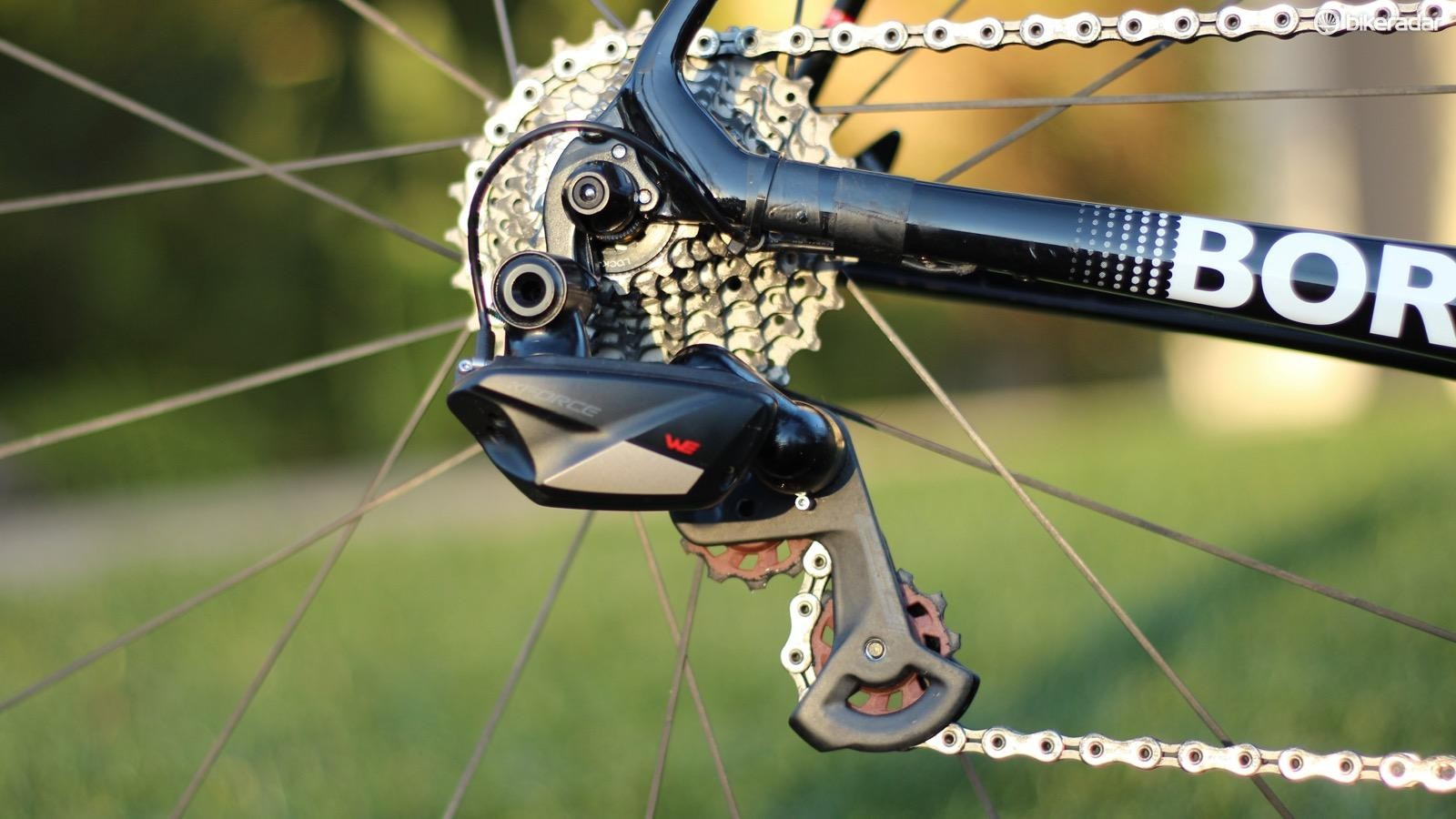 The rear derailleur works smoothly if not as fast as Shimano Di2. The wire is for power, not shifting