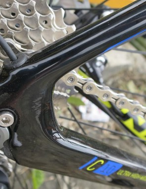 That small bolt above the 12mm thru-axle means you can remove the threaded piece, converting the back end to a QR 135mm