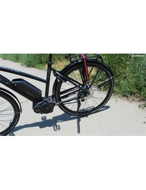 Practical included features include a sturdy kickstand, rack, securing strap and integrated lock