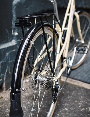 An integrated pannier rack and full mudguards make this a very practical option