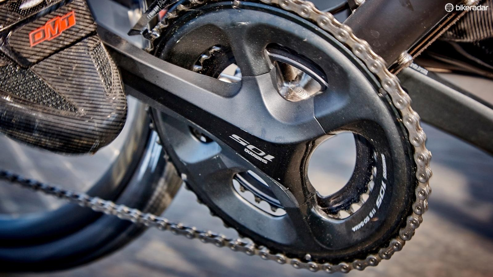 The compact 50/34 crankset is specced in black _ our experience suggests this looks ace, until you scratch it