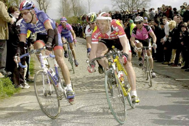 Big George (L) and Andrei Tchmil in flanders coming off the cobbles in 2001.