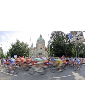 Riders race past the town hall in Hanover during the final stage of the Tour of Germany