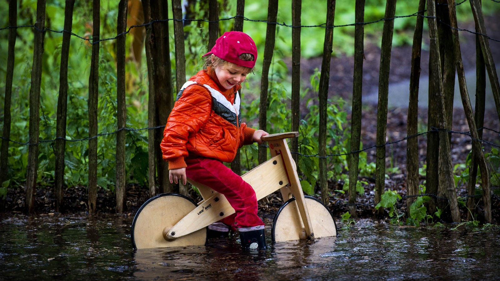 Playing outside in the rain, on a bike – what kids were meant to be doing