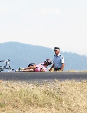 Stricken Spaniard Joseph Beloki (centre) broke several bones at the 2003 Tour due to melting tarmac