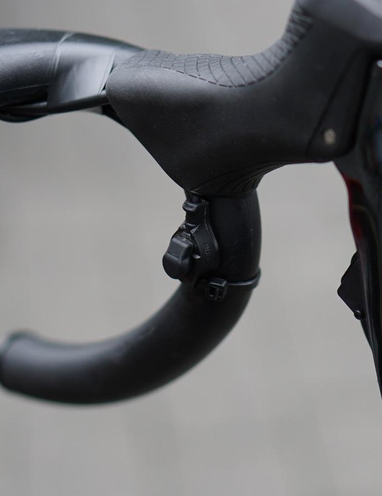 Shimano's Di2 sprint shifter clips onto the handlebars, and can be wired into the shifter or a junction box
