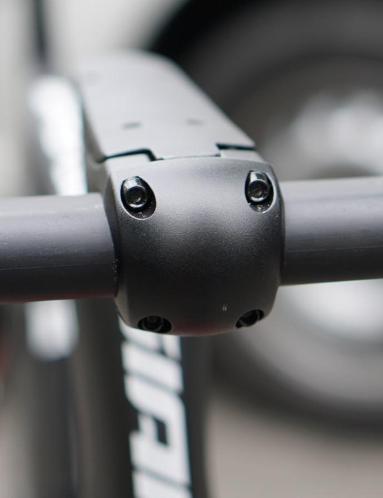 While the frame is branded and looking to be production-level, the stem and handlebar reamin blank