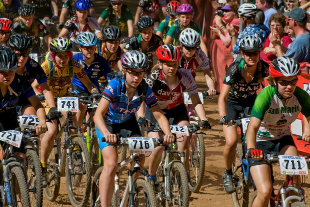 Freshman and sophomore girls kick up dust at the California State Championships start line.