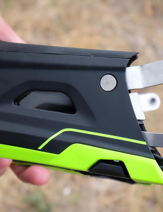 The Switchblade's chin bar uses metal guides that pivot down into the hooks that lock it in place