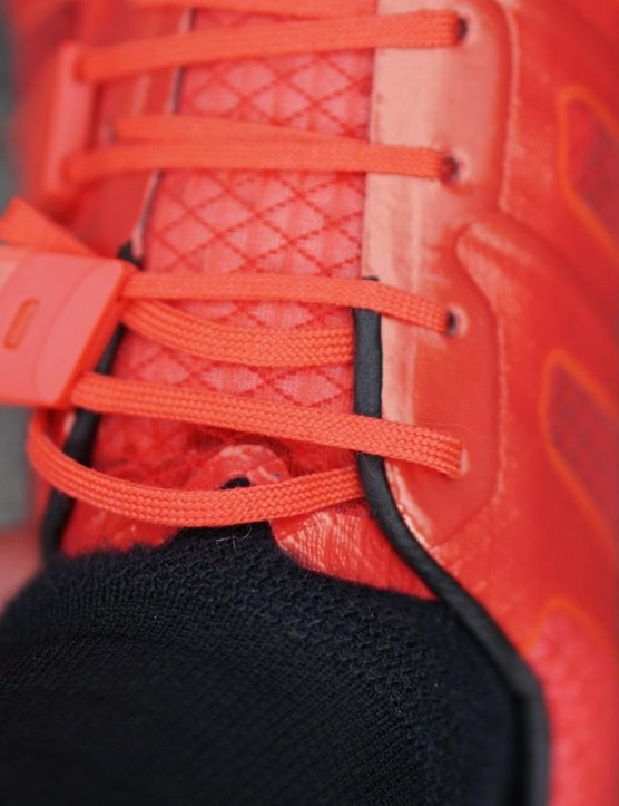 I found that pulling on the straps without lifting them up can trap the lower laces, resulting in a looser fit as the upper and lower gradually balance out as you ride