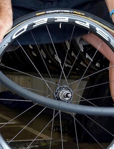 After putting the rim in the tray with the valve hole at top dead center, Bacchion begins to quickly and evenly stretch the tyre onto the rim