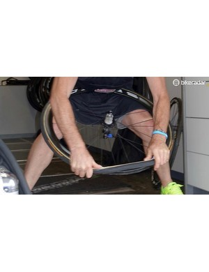 Bacchion pops the rest of the tyre on with his thumbs. You can also use your palms as they are stronger than your thumbs. Remember the tyre is dry so you can manhandle it. Just try not to smear the glue on the rim, causing a mess