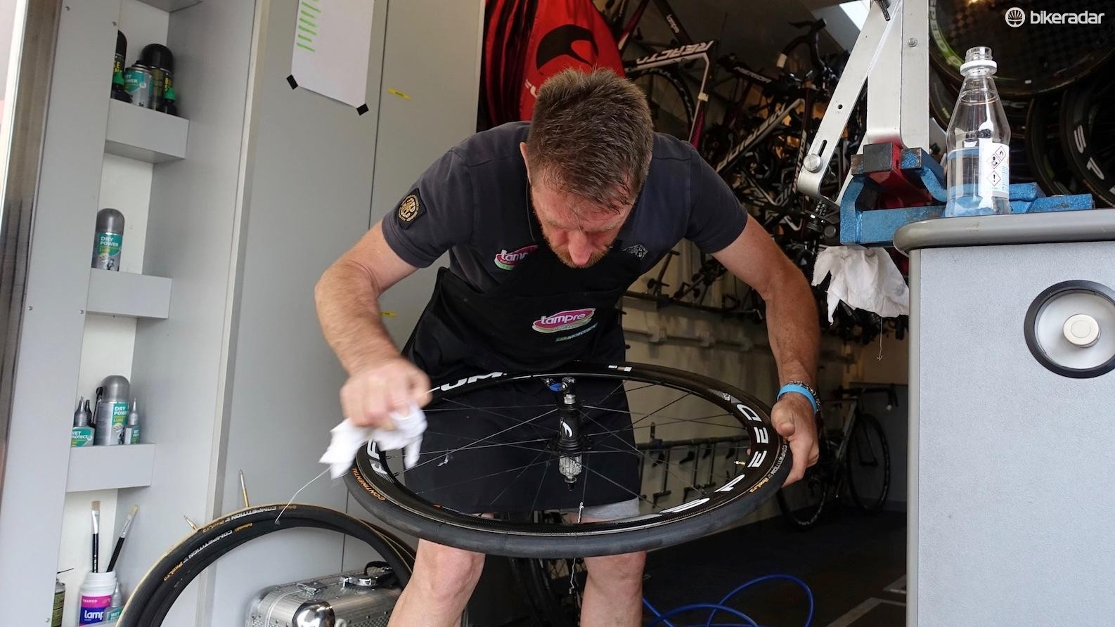 Lastly, the Italian mechanic wiped off any glue that seeped out after he pressed the tyre into the rim. Done