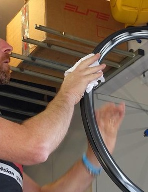 Last step in prepping the rim is a wiping the rim bed with a clean, solvent-soaked rag. This removes any debris and reactivates the existing glue on the rim
