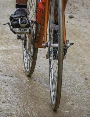 Rainy conditions turned the normally white and dusty strade bianche into brown and muddy