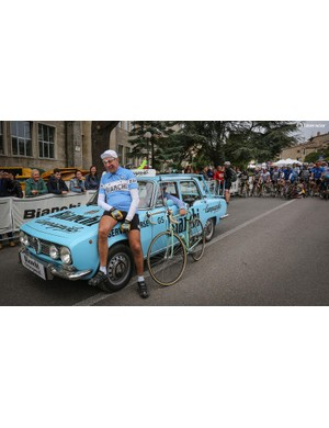Gimondi poses for the cameras with his vintage Bianchi and team car