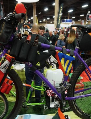 Need to transport a bunch of beer on your bike? Green Guru has fork sleeves and an insulated six-pack holder that drapes over a top tube