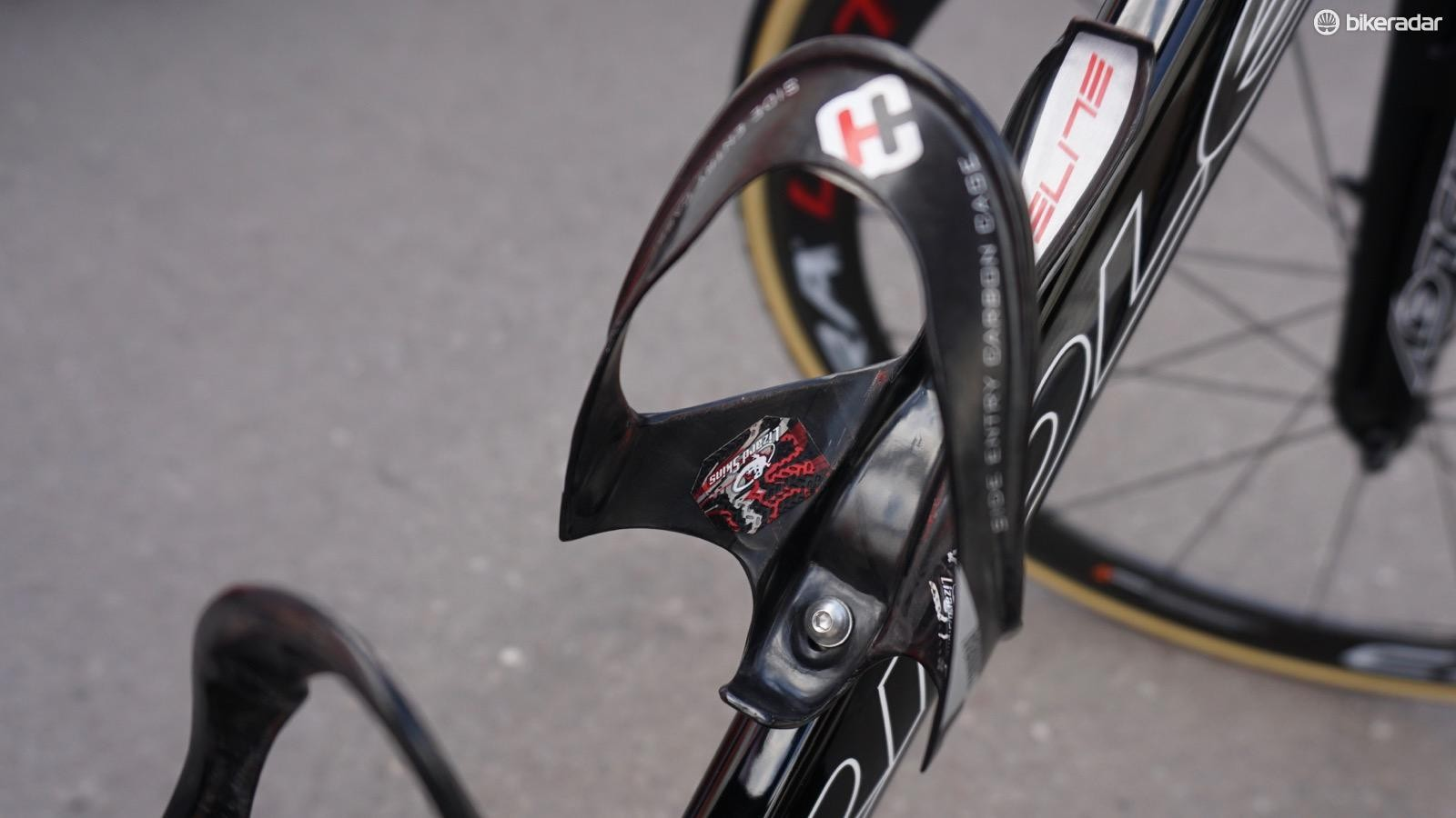 Lotto-Soudal mechanics use a bit of Lizard Skin bar tape to keep bottles from ejecting