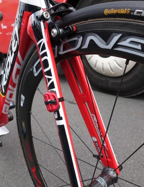 The only bike in the peloton with holes in the fork legs, the Noah uses them to help smooth turbulence between the front wheel and fork legs. A timing transponder is zip-tied to the right leg