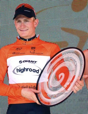 Andre Greipel wins some interesting Tupperware for his kitchen.