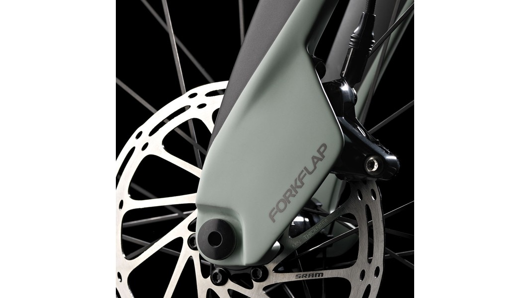 The bike features aero-friendly flaps that shroud the front caliper