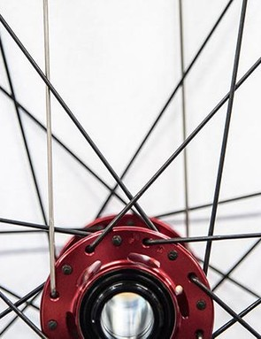 1. 32 or 36 J-bend spokes are used in a three cross arrangement