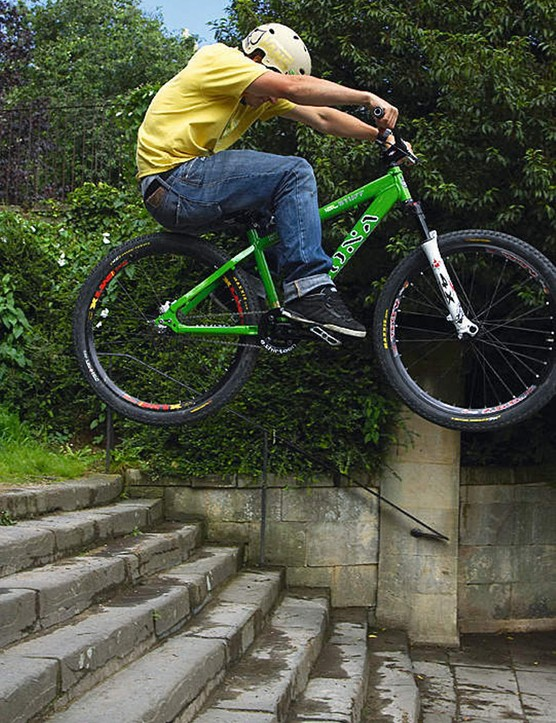 As you go off the edge, don't pull up as if you're aiming to get more air, just pull up enough to stop the front wheel dropping away from you.