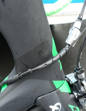 A Di2 wire nestles around the rear brake cable, with its quick release located in front of the head tube