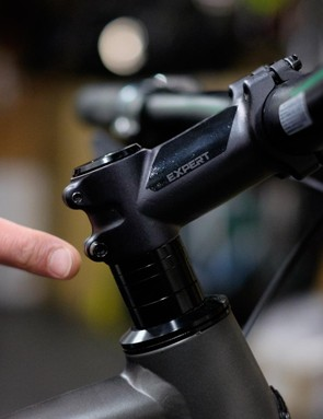 This bike features four headset spacers. The piece below the fourth spacer is the headset bearing cover and should not be removed