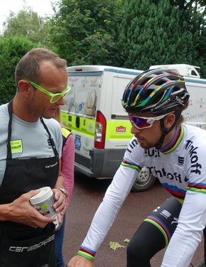 World Champ Peter Sagan speaks with his mechanic Christophe Desimpelaere prior to a training ride. Specialized prepared a black world's rainbow edition for Sagan. It's also likely that the American manufacturer has green, yellow and polka dot versions hidden away just in case