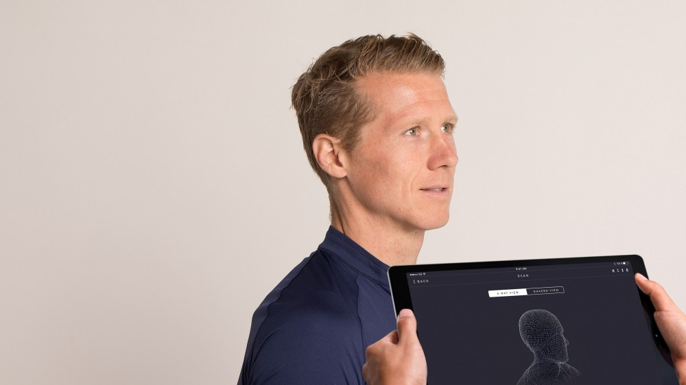 Head measurements are taken using a scanning app on an iPad