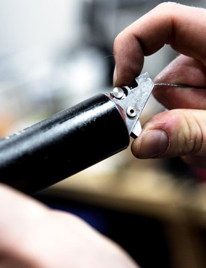 Plug the outer cable ferrule into the port before you pull the inner cable taut