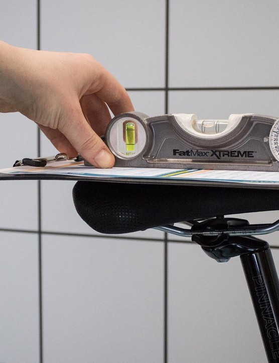 The saddle is set to a level position for the bike fit