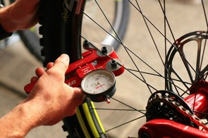 A spoke tension meter is used to make sure the wheels suit the rider and are consistent between wheel builds