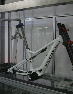 Canyon's in-house testing facility features machines Canyon built themselves, including this one testing frame stiffness when forces are applied to the fork