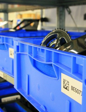 Walk around the assembly plant and you'll spot boxes filled with a Dura Ace crankset here, an XTR brake there. It's a bike nerd's sweet shop