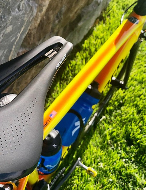 The frame features an orange/yellow fade paint design