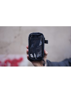 Your phone goes into the front bit, behind a touchscreen-compatible plastic screen