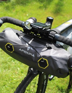 The Apidura front bar bag fitted nicely between my handlebar drops. Note also the front light, for long Alpine tunnels
