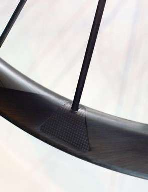 The spokes are glued onto the one-piece carbon rim via these little triangular sections