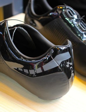 Reflective details combine with the shiny black finish