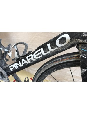 The F10's mud-splattered concave downtube