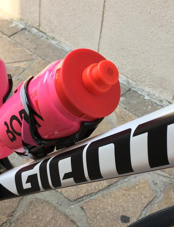 Pink bidons and bottle cages provided by Italian brand Elite