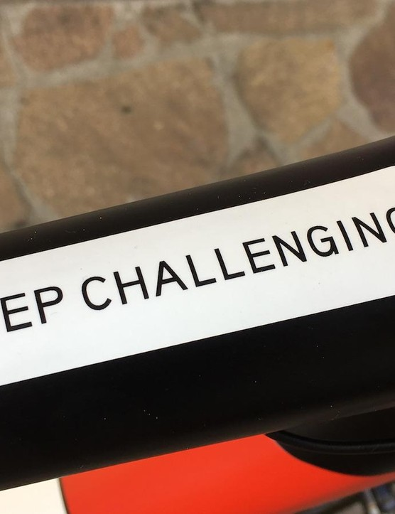 The team's motto sits on the top tube in site of Dumoulin whilst riding